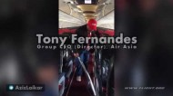 Tony Fernandes (Group CEO, Director, AirAsia) assisting crew on Flight AK6306